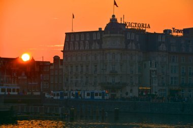 AMSTERDAM NETHERLAND 10 03 15: Silhouette of Park Plaza Victoria Amsterdam. It was the first hotel in the country to have electric lighting