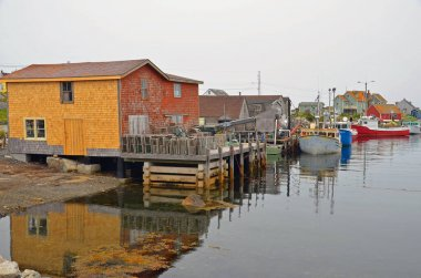 PEGGY'S COVE NOVA SCOTIA JUNE 6: Typical fisherman shack in Peggy's Cove a small rural community located on the eastern shore of St. Margarets Bay in Nova Scotia on june 6 2014.