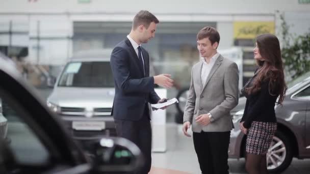 salesman shows couple information