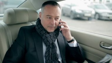 Mature businessman using phone