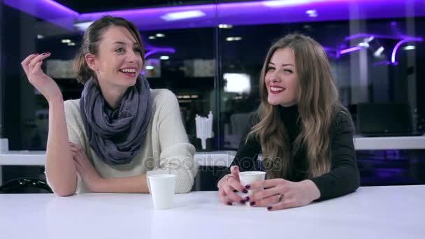 beautiful girls talking in cafe.