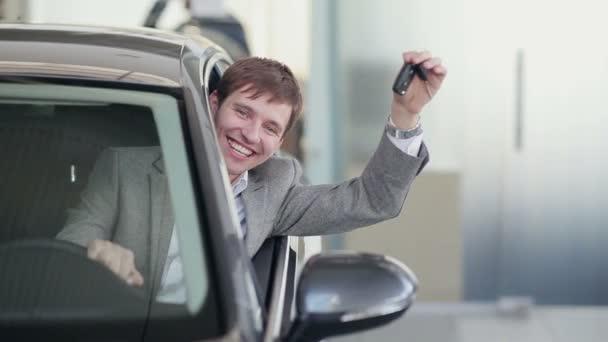 Happy guy shaking keys