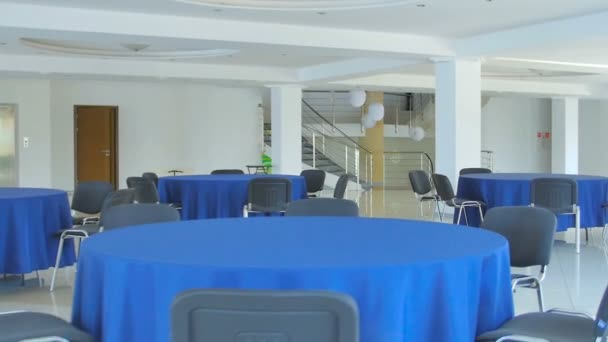 empty interior with blue table and chairs in modern business building