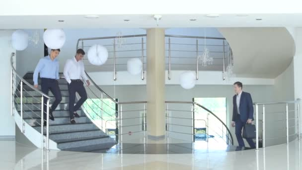 young business men on stairs of modern office building