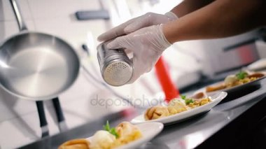 Hands decorate plate with food & Well decorate food u2014 Stock Video © probakster #97565892