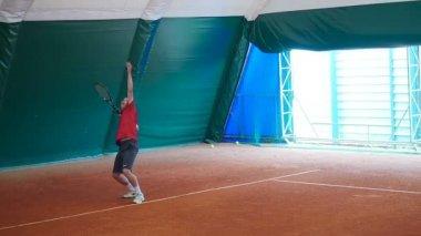 Man playing big tennis