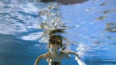 Father teaching boy swimming
