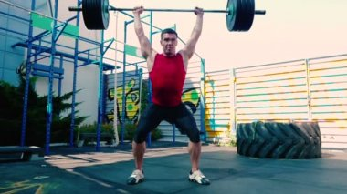 man workout with Barbell