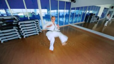 Woman practicing karate in gym