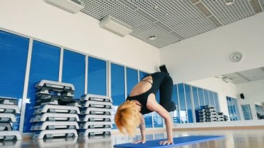 redhead woman practicing yoga