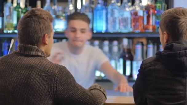 barman make cocktail at bar