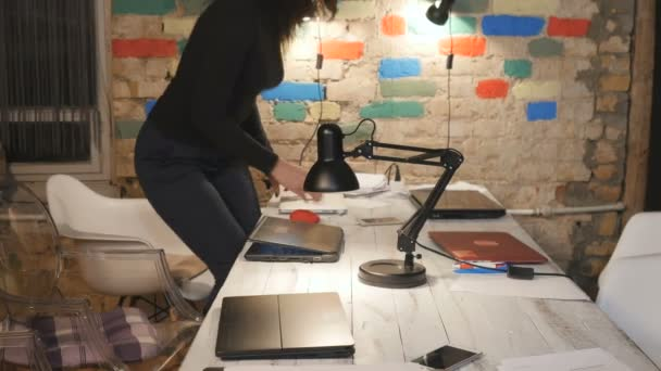 Young people start working in the office with laptops
