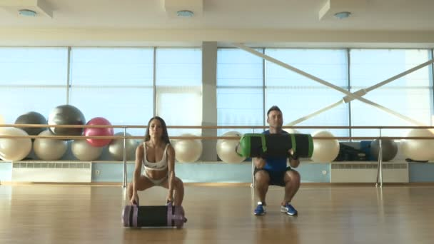 woman and man training in gym