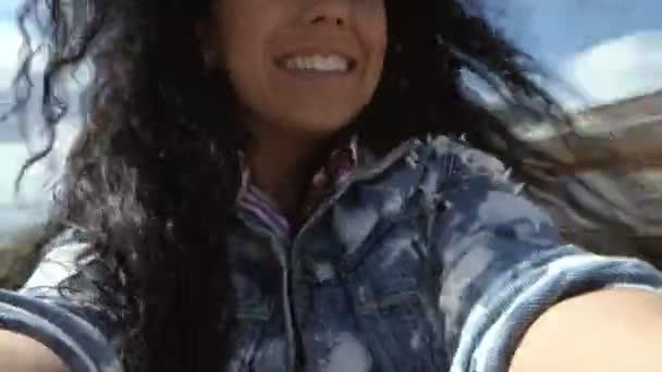 Happy brunette spinning around herself with camera in hands