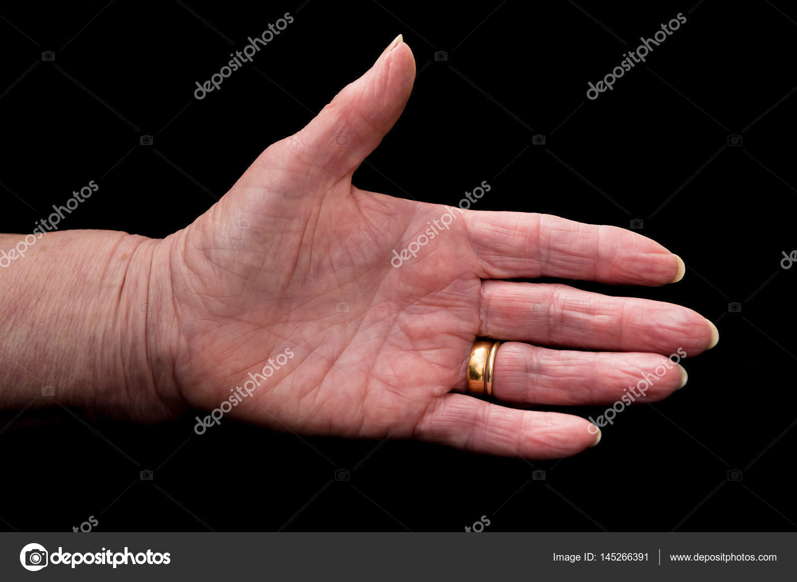 Mature woman\'s hand in greeting gesture. On black. — Stock Photo ...