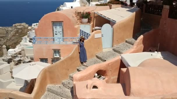 Fira, Greece - June 20, 2019: casual view on the street life at the capital of Santorini Island at sunny  weather
