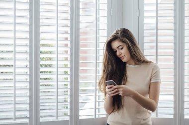 Teenager Texting at Home