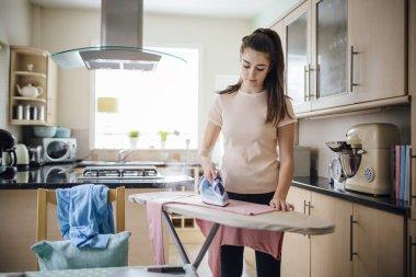 Teenager Ironing Laundry