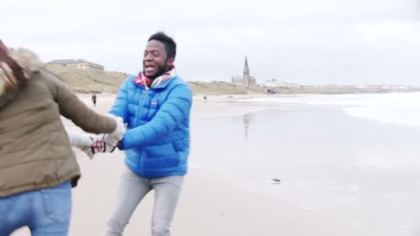 Young Couple Dance On A Winter Beach