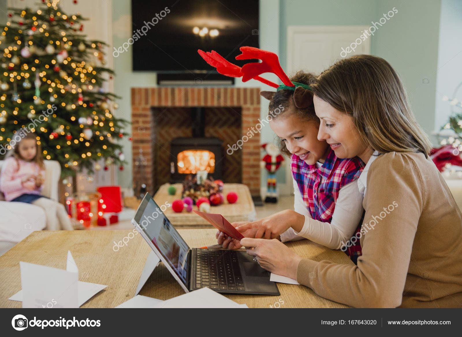 writing christmas cards with mum stock photo dglimages 167643020