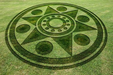 Concentric circles star fake crop circle in the meadow