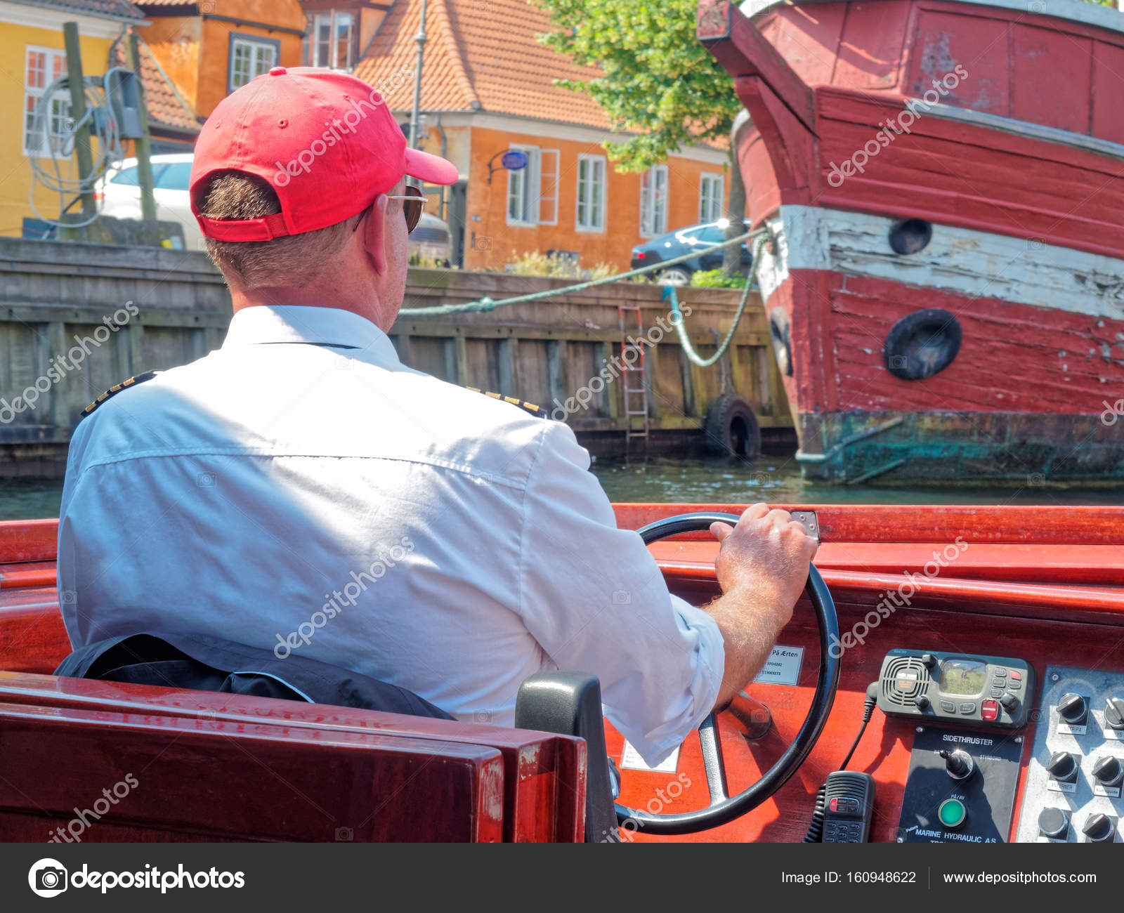 8cce88ed Copenhagen, Denmark - June 2016: Man driving touristic motorboat along the  canal — Photo by canbedone