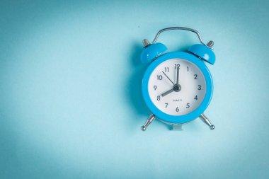 Morning concept - vintage clock on blue background