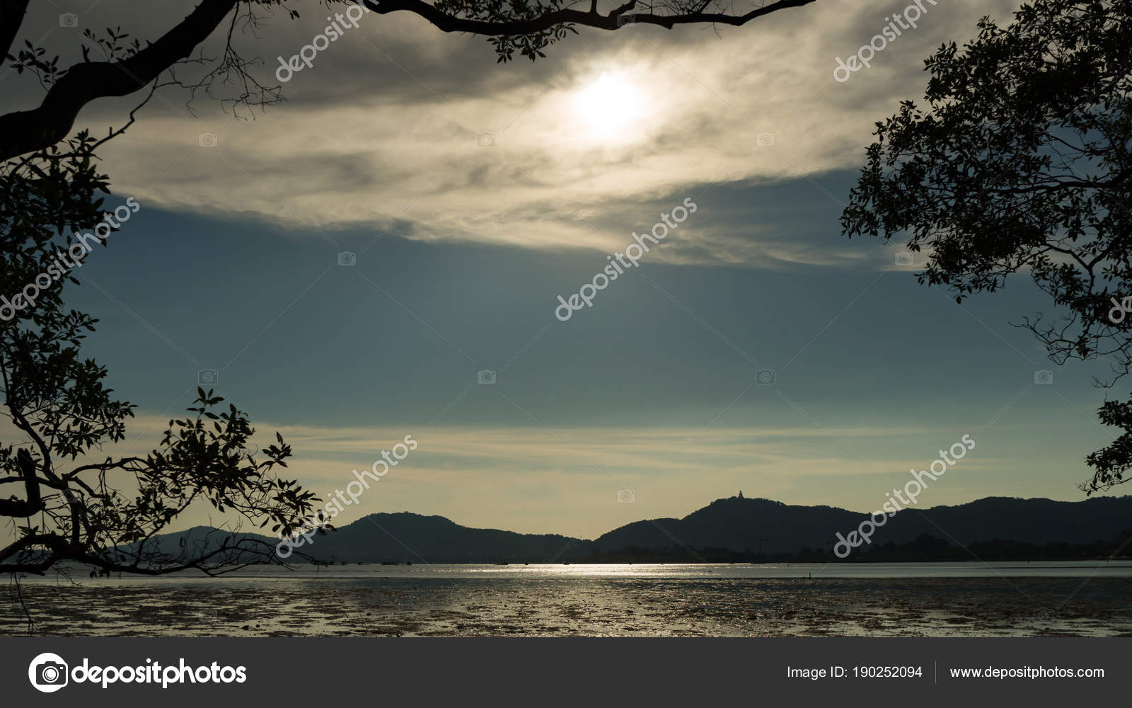 trees and leaves frame with tropical sea in evening time. — Stock ...