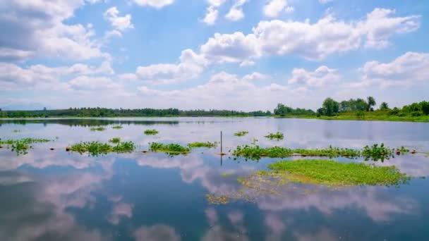 Reflection of clouds in water over lake Timelapse táj természet felvételek