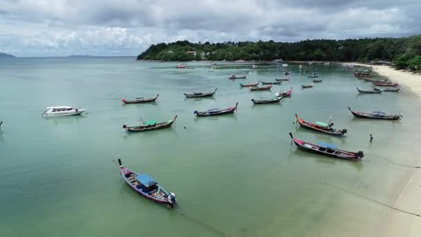 Aerial View of Thai traditional longtail fishing boats in the tropical sea beautiful beach in phuket thailand