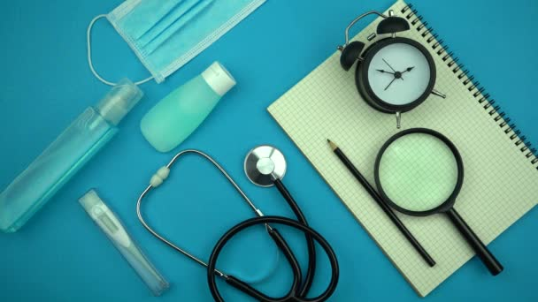 Coronavirus or Covid-19 Medical mask with Stethoscope,Electronic thermometer and syringe on table