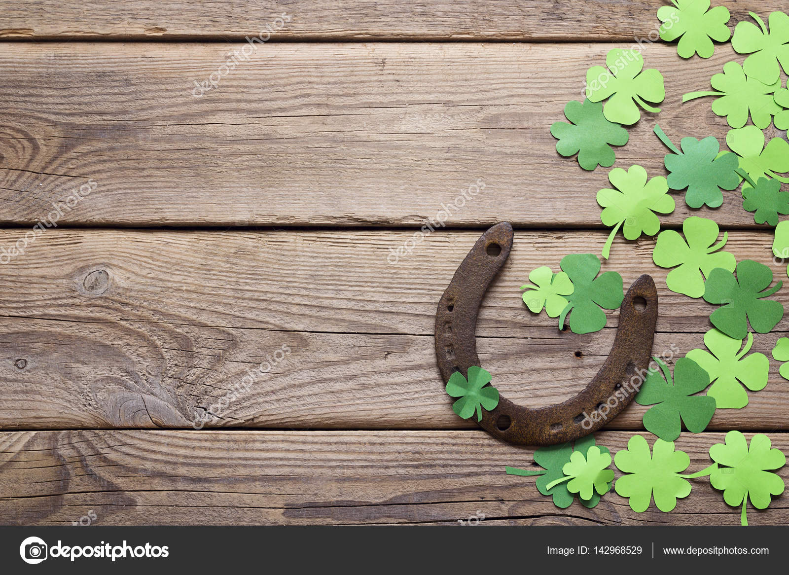 Background with rusty horseshoe and paper clover leaves on the o background with rusty horseshoe and paper clover leaves on the o stock photo biocorpaavc