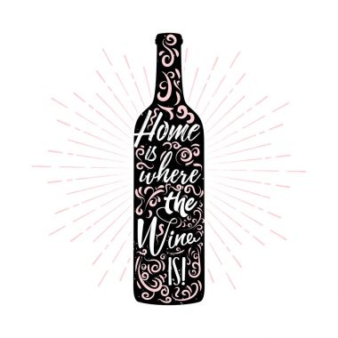 Home is where the wine is - lettering inside a wine bottle with ornament