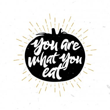 You are what you eat - quote inside the tomato.