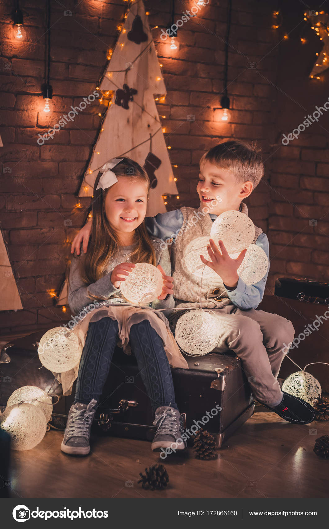 Christmas Babes.Lovers Are Babes In Christmas Studio Stock Photo