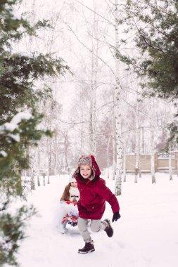 Kids games winter fun, sledge, friendship, boy and girl