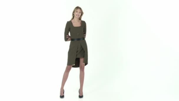 fashion model in green dress on a white background