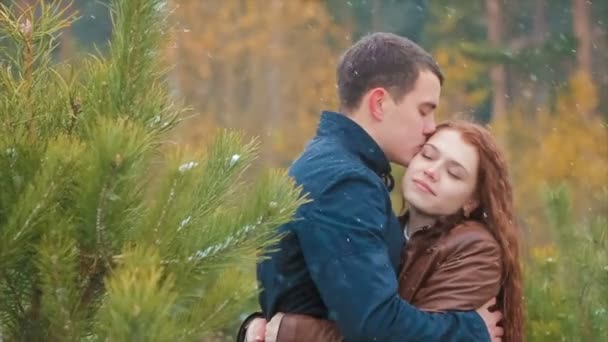 Man Whispering Something to a Girl at Snowfall