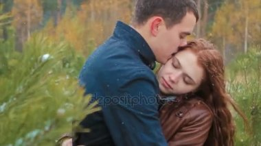 Young Couple Embracing in Autumn Forest