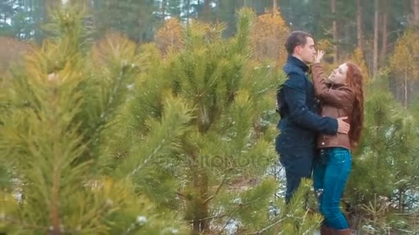 Young Couple Standing in Winter Forest