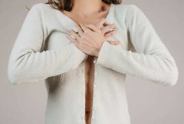 woman feeling pain in her chest. Health concept