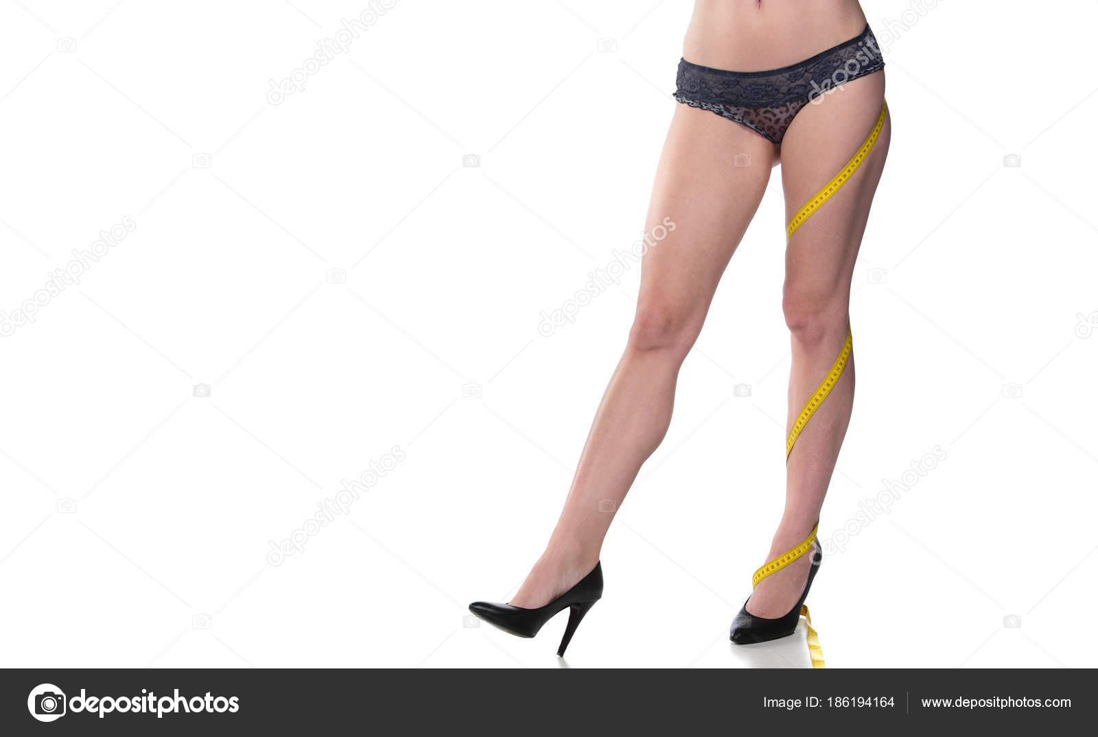 a2d965589034 Beautiful woman s legs with high heels and measuring tape raped around leg.  isolated on white — Photo by ...