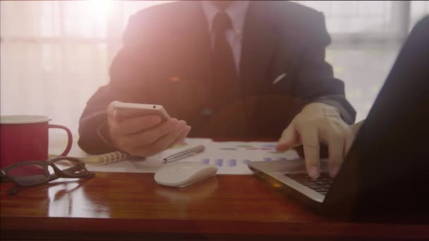 Businessman or accountant working to calculate business data with lens flare concept. Accounting,investment advisor consulting situation on the financial report and planning a marketing plan at office