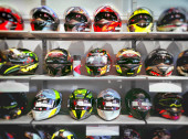 motorbike sports helmets on the shelves of a specialized shop