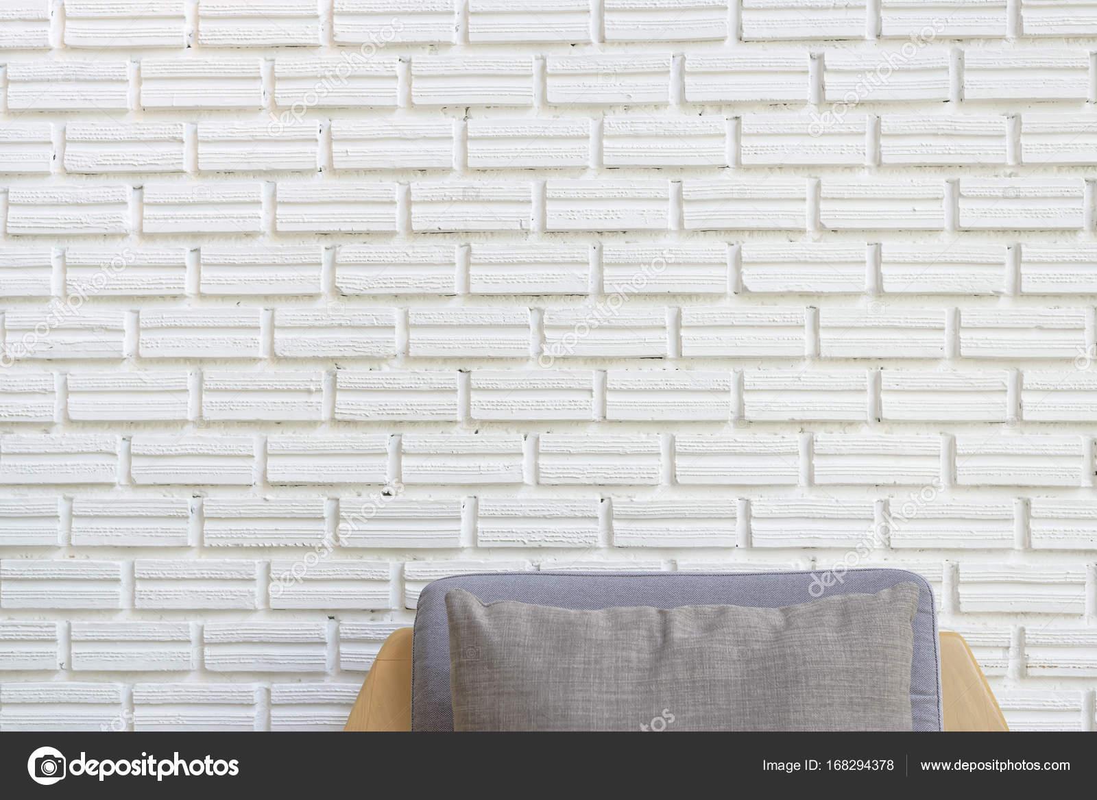 Rinc n acogedor sof con pared de ladrillo blanco foto - Pared ladrillo blanco ...