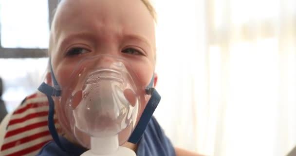 baby screaming crying in nebulizer mask vapor