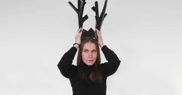 Model wearing artificial black horns