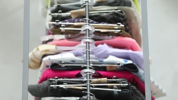 Sale of clothes on hangers among people from above