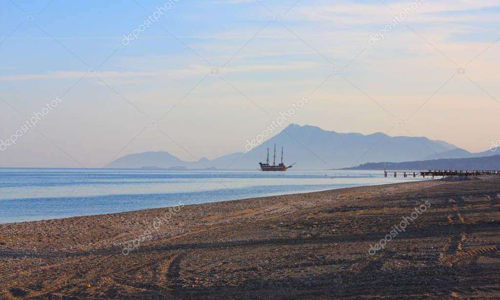 Red sailing ship in the sea