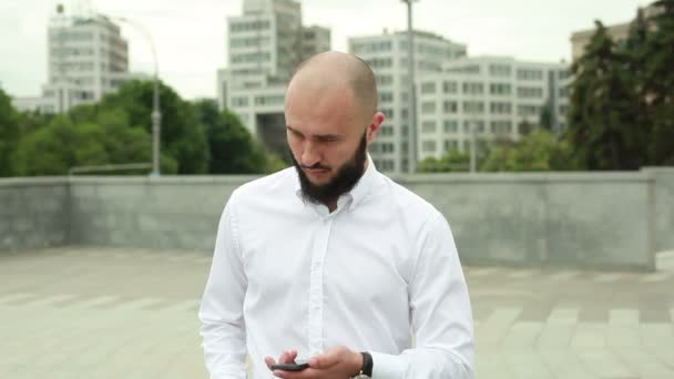 Man in shirt with beard enjoying success